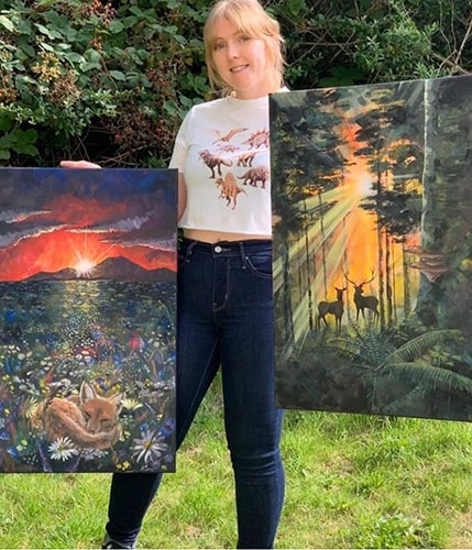 Alice Sims portrait outdoors holding selected paintings for sale with Lord and Lion Arts